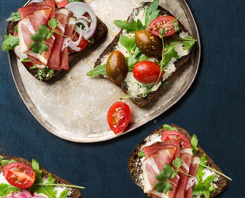 Goat cheese, prosciutto and artichoke hearts open-faced sandwich