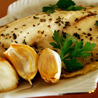 Tilapia fillets with coriander seeds