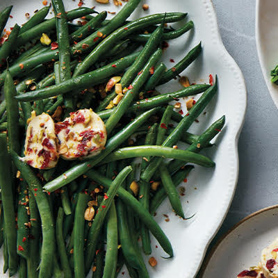 Harissa spiced green beans with Cranberry, pistachio butter