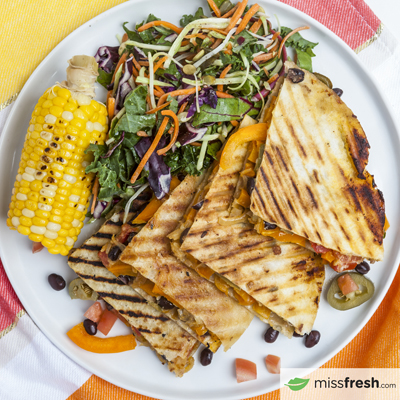 Vegetarian Quésadillas with Grilled Corn and Slaw Garnished with Pumpkin Seeds