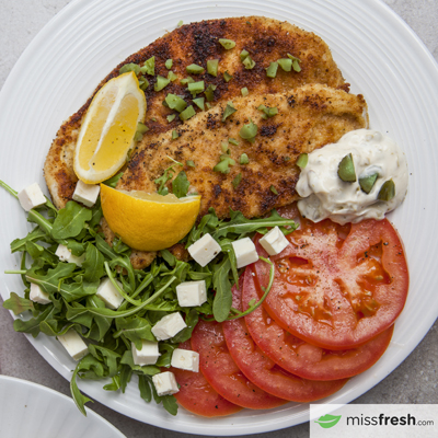Turkey schnitzel with Caper Mayo capers, Lemon and Tomatoes with Feta Cheese