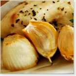 Unpeeled Garlic Bulbs on the Barbecue